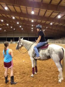 Riding a polo pony
